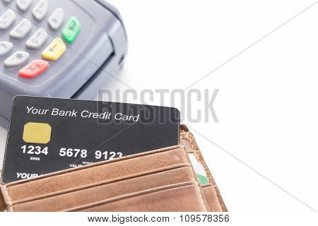 Credit Card In Wallet With Credit Card Machine In Background