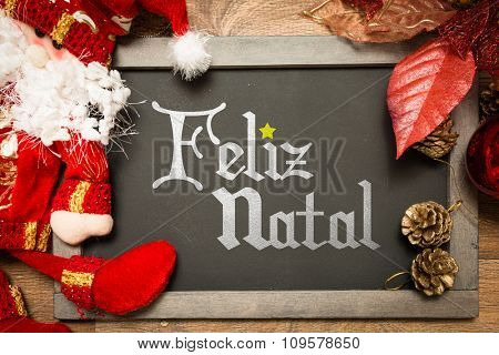 Blackboard with the text: Merry Christmas (in Portuguese)