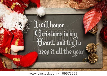Blackboard with the text: I Will Honor Christmas in My Heart, and Try to Keep It All the Year