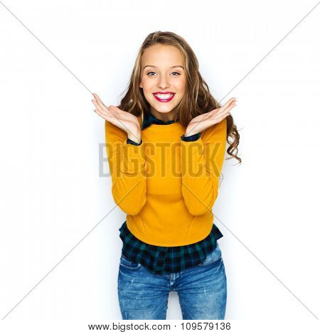 people, style and fashion concept - happy young woman or teen girl in casual clothes having fun