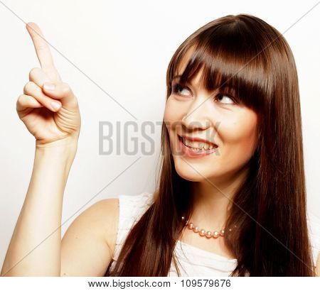 young happy woman with her finger up