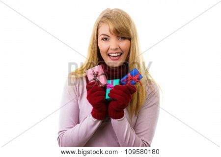 Smiling Woman In Woolen Gloves With Wrapped Gifts For Christmas Or Other Celebration
