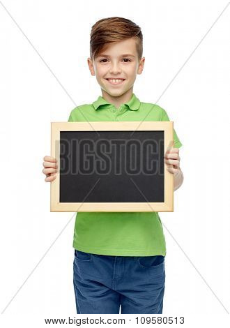 childhood, education, school, advertisement and people concept - happy smiling boy in green polo t-shirt holding black blank chalk board