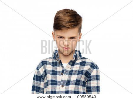childhood, emotion, anger, hate and people concept - angry boy in checkered shirt
