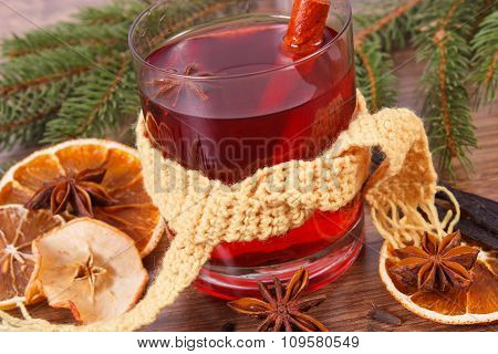 Glass Of Mulled Wine Wrapped Scarf, Spices And Spruce Branches