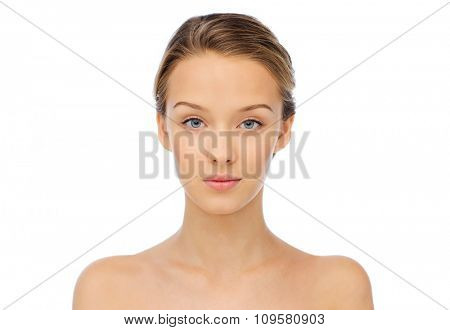 beauty, people and health concept - young woman face and shoulders