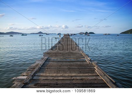 Tropical Wooden Pier In Turquoise Sea