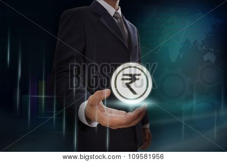 Businessman showing rupee sign icon on screen. business concept