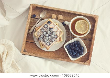 Breakfast In Bad,  Tray With Belgian Waffles With Blueberry And Cup Of Lemon Tea