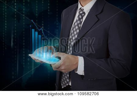 Businessman hand touch screen growth chart on a tablet, communication concept.