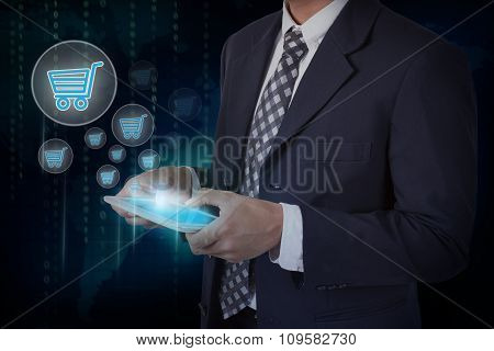 Businessman hand touch online shopping icons on a tablet