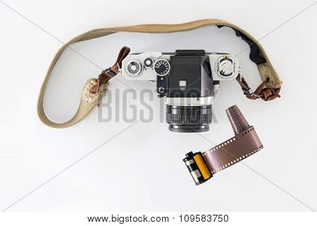 Retro Camera And Film Cartridge (top View) On White Background