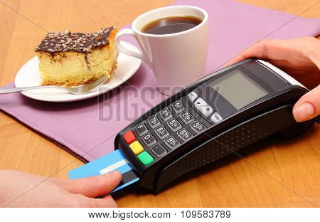 Use Payment Terminal For Paying For Cheesecake And Coffee In Cafe, Finance Concept