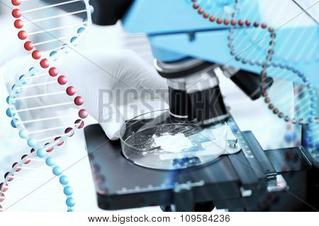 science, chemistry, biology, medicine and people concept - close up of scientist hand with microscope and powder test sample making research in clinical laboratory over dna molecule structure