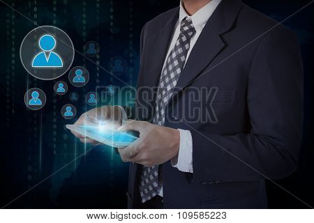 Businessman hand touch screen social network icons on a tablet