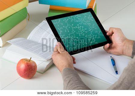 Student Learning Chemical Formulas On Digital Tablet
