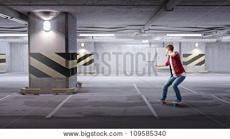 Handsome teenager cool acive boy riding skateboard