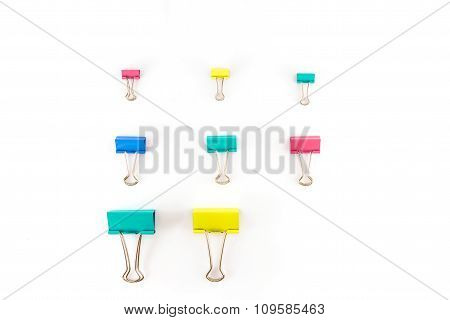 Color Paperclip On White Background