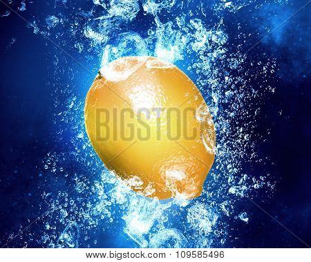 Lemon fruit in clear blue water splashes