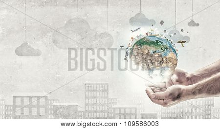 Hands holding Earth planet concept. Elements of this image are furnished by NASA