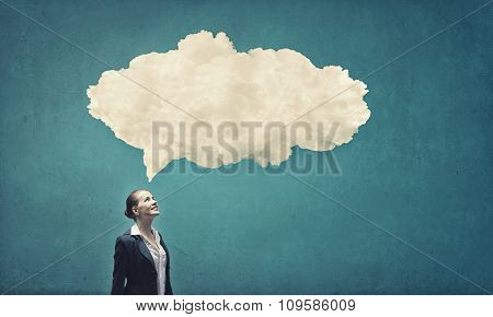 Thoughtful businesswoman and cloud bubble above her head