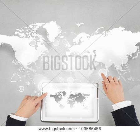 Businessman hands working on tablet with world map on screen
