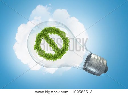 Conceptual image of green stop sign in glass bulb
