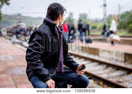 Traveler Looking At Crowd Waitning For Train