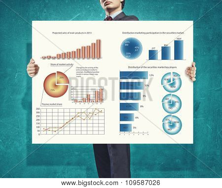 Businessman showing banner with drawn graphs and diagrams