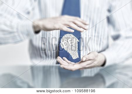 Hands of businessman holding with care idea concept