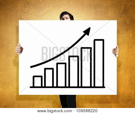 Businessman holding poster with growing arrow graph