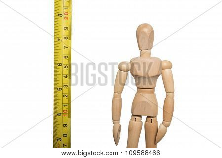 Human wooden figure with measurement tape, isolated on white background