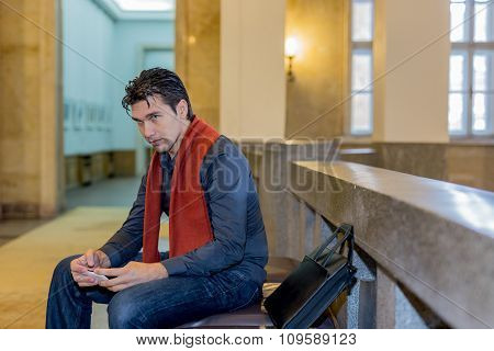 Sitting Man Holding Mobile Phone