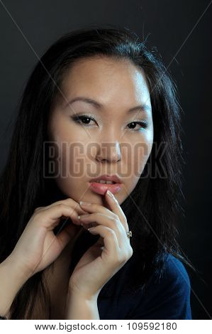 Portrait of asian woman on dark background