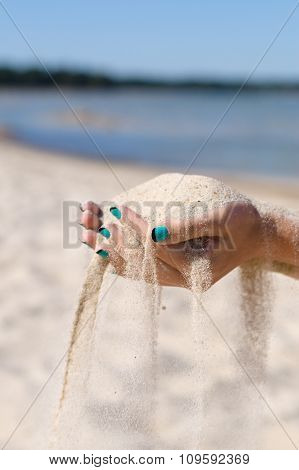 Sand Running Through Female Hands