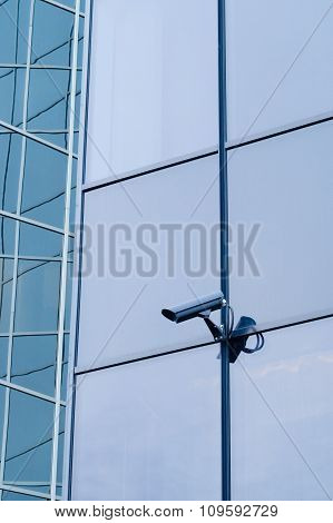 Outdoor Surveillance Camera On The Wall Of Modern Building