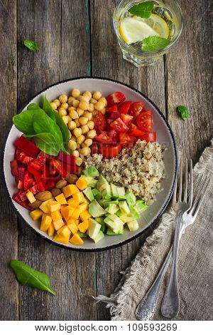 Healthy Salad With Quinoa, Chickpeas, Avocado, Bell Pepper, Spinach, Tomato And Pumpkin,
