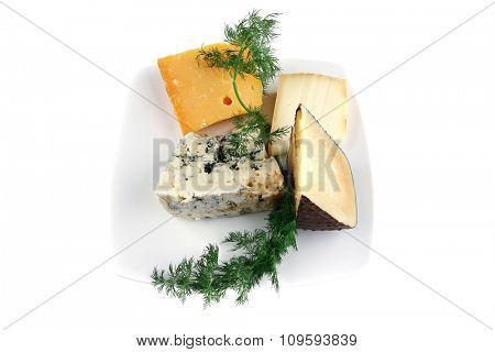 french aged cheeses on white ceramic plate