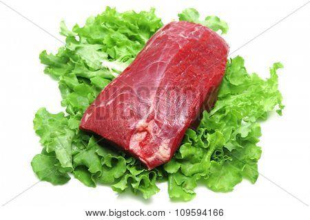 fresh raw beef on green salad