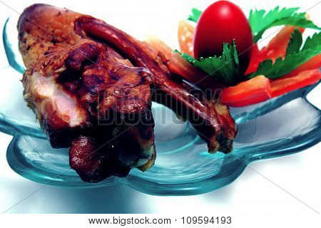grilled turkey wings on white with salad and tomatoes