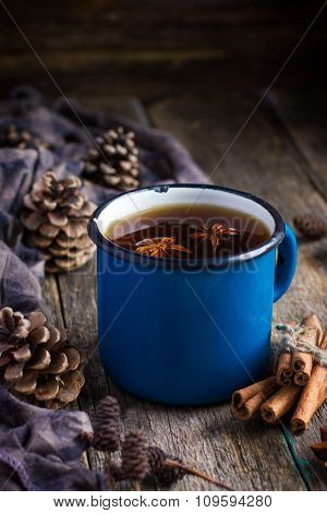 Hot Spicy Tea With Anise And Cinnamon In Vintage Blue Enamel Mug , Selective Focus
