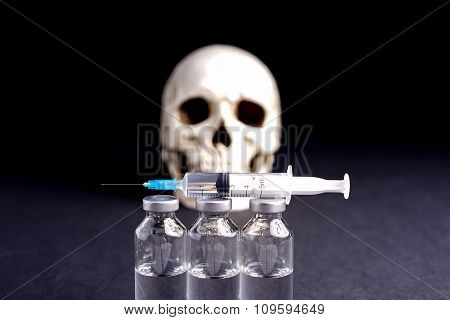 Skull, Syringe And Medical Vials