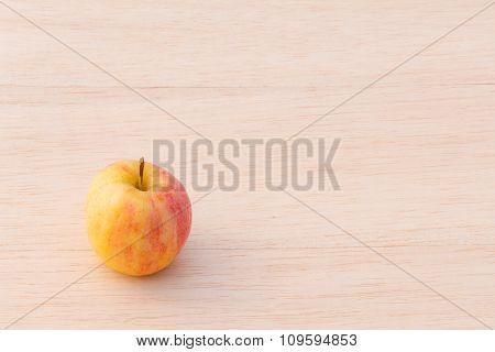 Fuji Apple On Wood Background