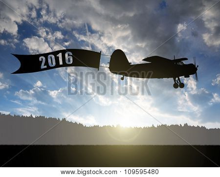 Engine airplane flying at sunset. Concept of New Year 2016