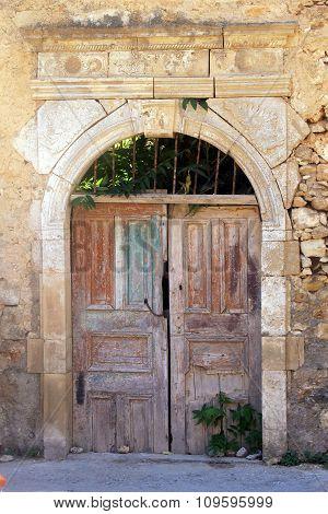 Old Weathered Broken Wooden Door, Greece