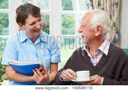 Senior Man With Carer At Home