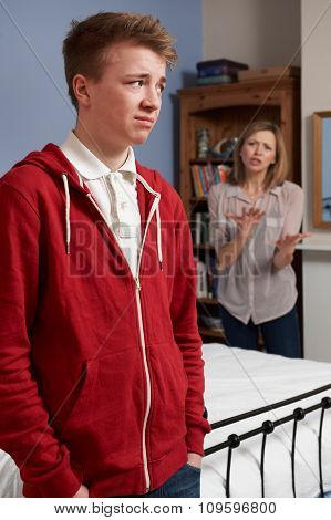 Teenage Boy Being Told Off By Mother