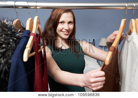 Teenage Girl Choosing Clothes From Wardrobe