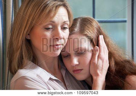 Mother Comforting Teenage Daughter