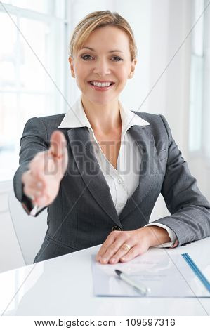 Female Businesswoman Extending Hand In Greeting